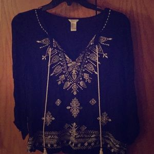 Super cute black blouse with white details